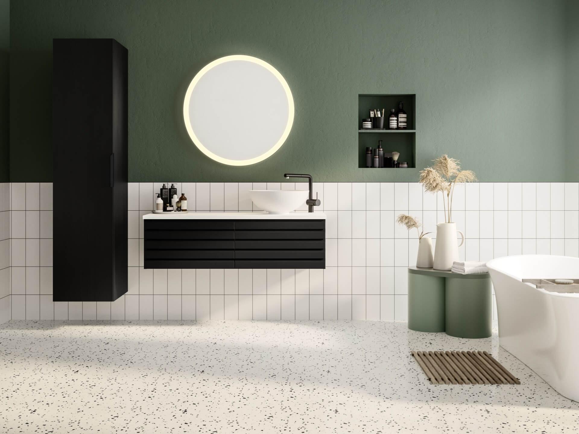 Miljøbilde servantskap Linn Bad Selma 120 og høyskap i sortmalt eik. Terrazzo gulv og grønne detaljer.